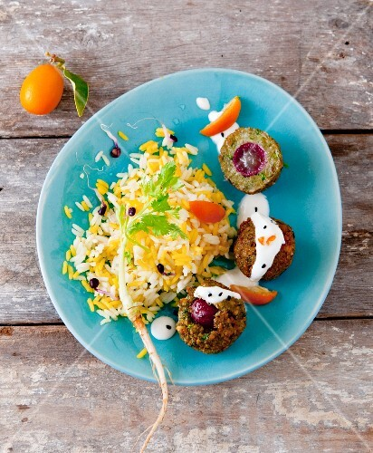 Falafel filled with grapes served with rice