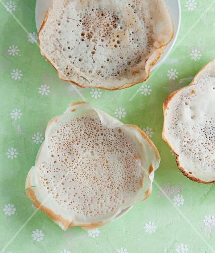 Hoppers or Appam (coconut and rice pancakes, India)