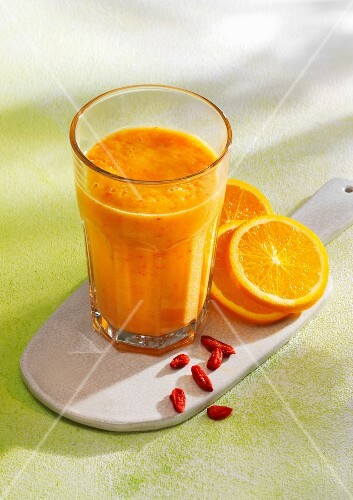 A sunshine smoothie made with bananas, pineapple, mango, oranges and goji berries