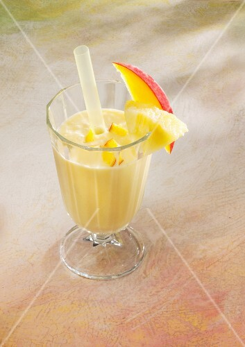 A pineapple and ginger smoothie with mango and almond milk