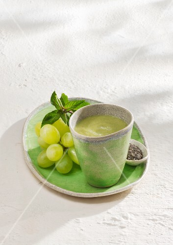A green tea smoothie with spinach, grapes, avocado and chia seeds