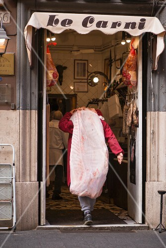 The entrance of a butcher's, Italy