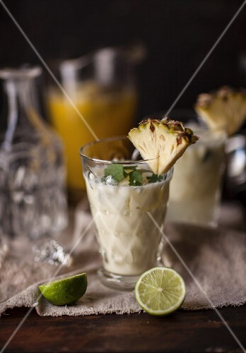 Tiger Milk cocktails with pineapple liqueur and pineapple