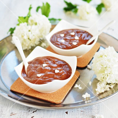 Two bowls of chocolate pudding with white sugar hearts