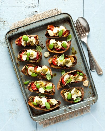 Potato skins filled with roasted tomatoes, goats cheese and pesto
