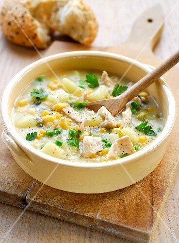 Spicy chicken soup with peas and sweetcorn