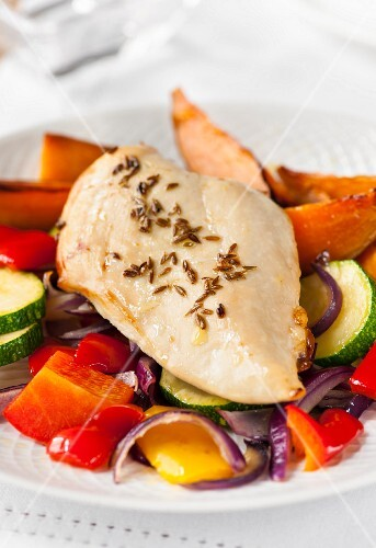 Chicken breast with sweet potatoes and oven-roasted vegetables