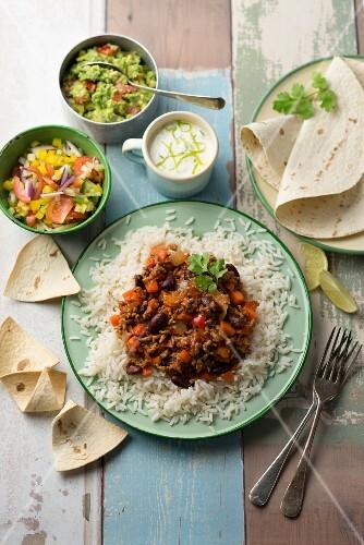Chilli con carne with rice, salsa, guacamole and sour cream