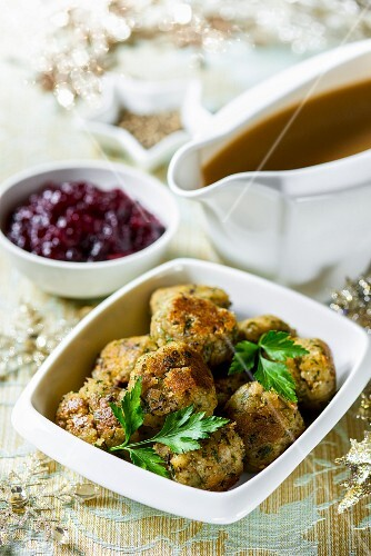 Christmas side dishes: bread stuffing balls, cranberry sauce and gravy