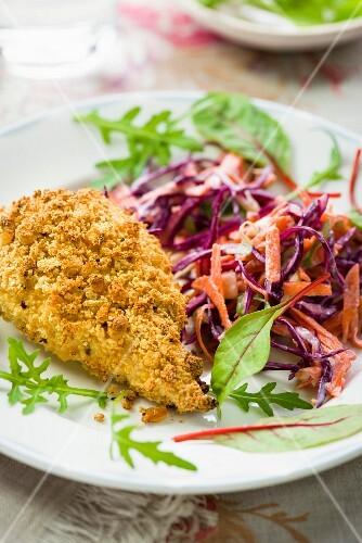 Crispy breaded chicken breast with coleslaw