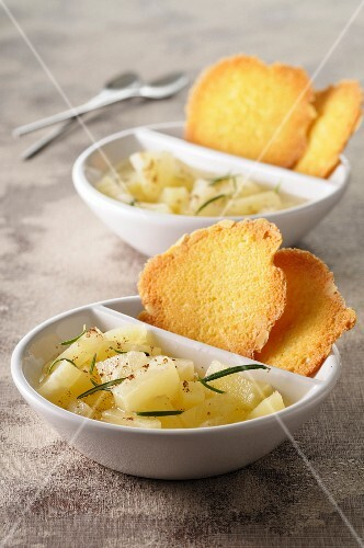 Pineapple tatar with basil and Szechuan pepper served with orange tuiles