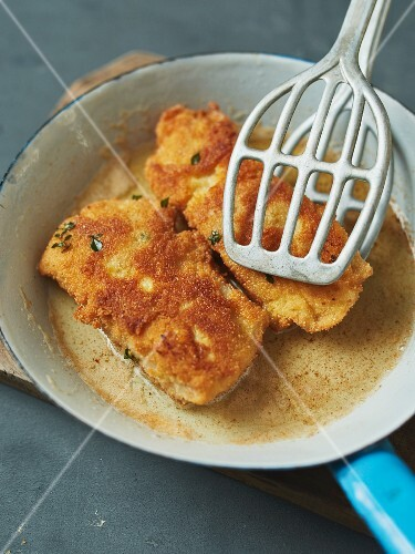 Breaded fish fillet in a pan