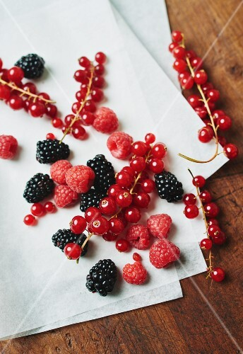 Red berries on a piece of white paper