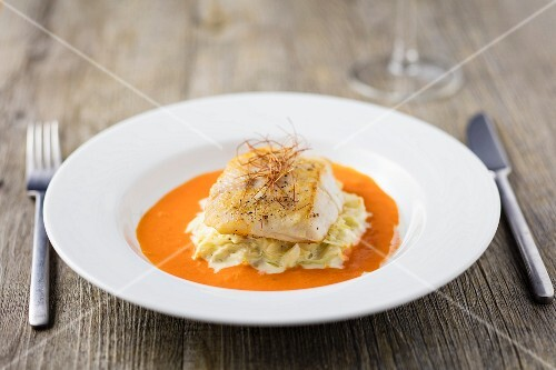 Nile perch on a bed of creamy sauerkraut in a pepper sauce