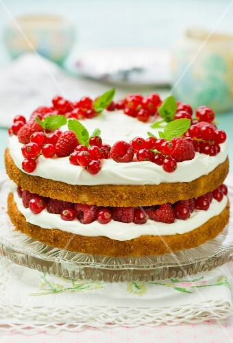 Victoria Sponge with summer berries and mint leaves