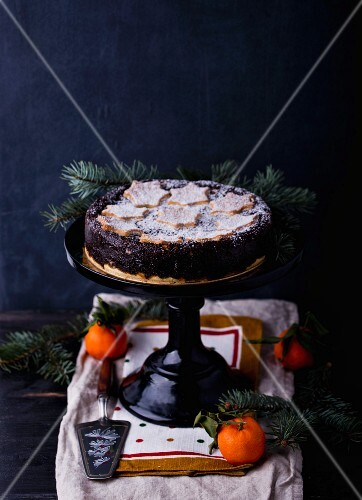 A poppyseed cake on a cake stand (Christmas)