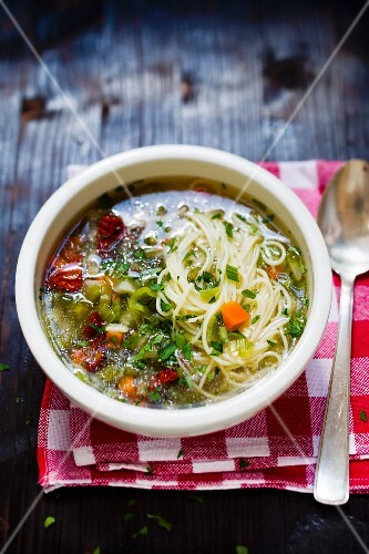 Noodle soup with vegetables in a soup bowl
