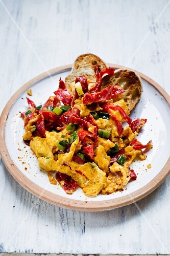 Spoonfuls of scrambled eggs with diced chorizo