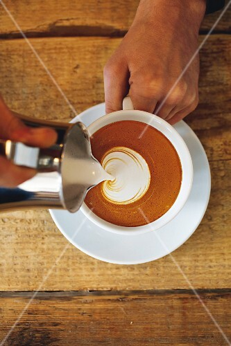 World Champion latte art: a cappuccino with a milk pattern being made
