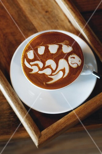 A milk pattern on a cup of coffee