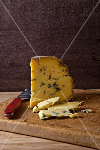 Blue cheese on a rustic chopping board with a knife