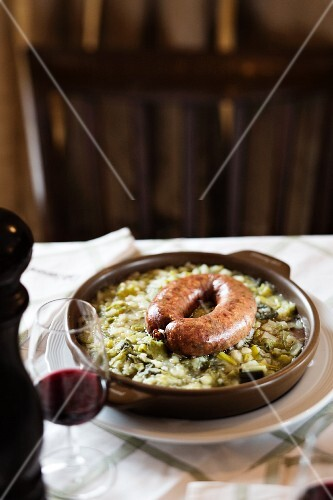 A dish from the restaurant 'Cafee Romand' in Lausanne, Vaud cabbage sausage with a leek and potato bake, Lake Geneva, Switzerland