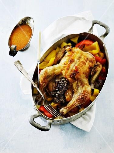 Stuffed roast chicken with a pepper medley