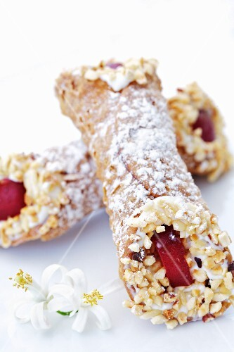 Cannoli siciliani (fried pastry rolls filled with ricotta cream, Italy)