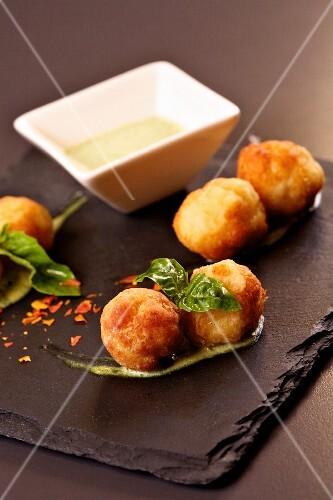 Fish balls with a yoghurt and pesto sauce
