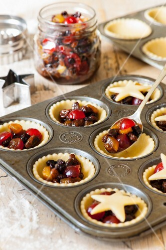 Mince pies with sultanas, cherries and raisins being made