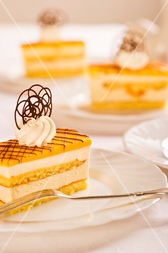 Egg liqueur slices decorated with cream and chocolate flowers