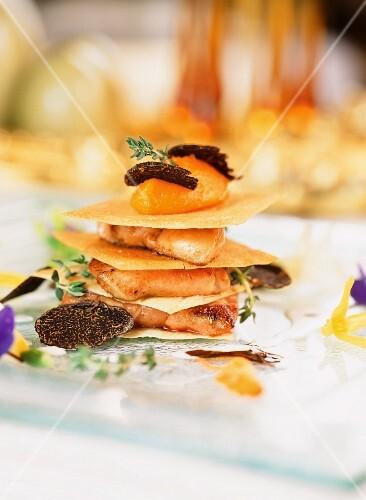 Crispy goose liver lasagne with pumpkin purée and a truffle sauce
