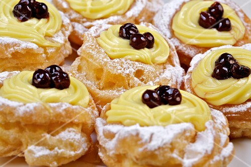 Zeppole di San Giuseppe (choux pastries filled with cream and amarena, Italy)