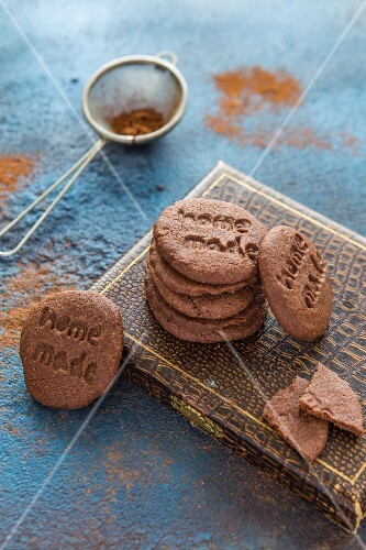 Homemade chocolate biscuits dusted with cocoa powder