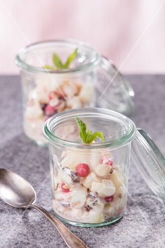 Bircher muesli with redcurrants in jars
