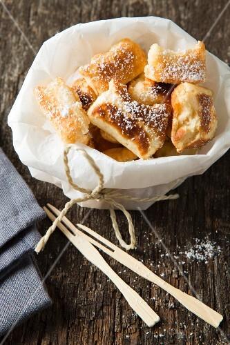 Shredded pancake with wooden forks