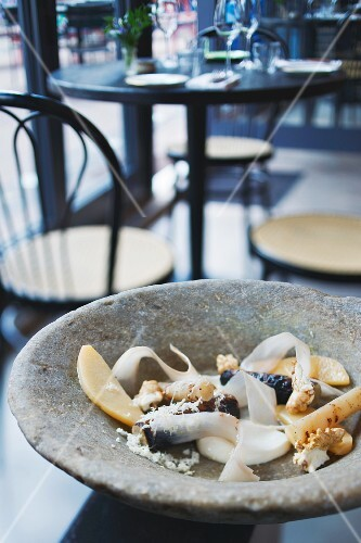 Black salsify, smoked quark, preserved quince and walnuts from the 'Paradise Garage' restaurant, London, England