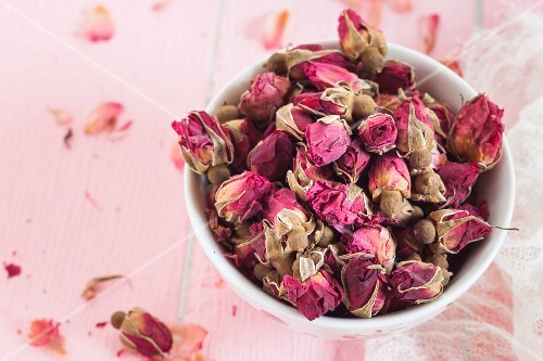 Bowl of dried Moroccan rosebuds for making rose tea