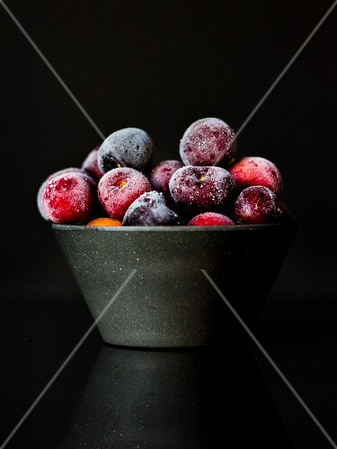 A bowl of frozen cherries