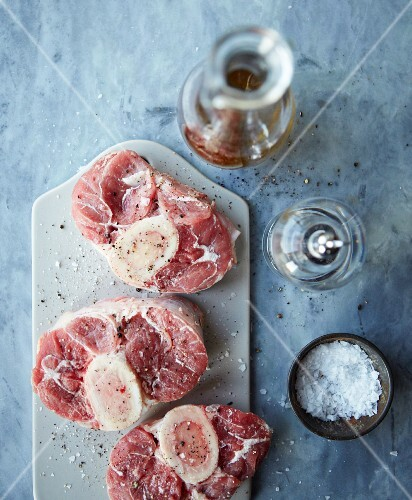 Raw osso buco with salt and ground black pepper