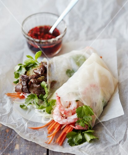 Rice paper rolls filled with glass noodles, prawns, beef, carrot strips, mint and coriander (Vietnam)