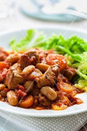 Pork ragout with beans and tomatoes