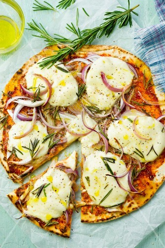 Onion pizza with mozzarella and rosemary, sliced
