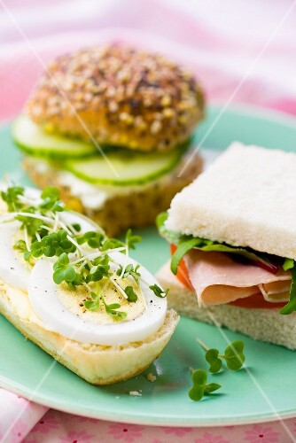Sandwiches with egg and cress, cucumber and ham
