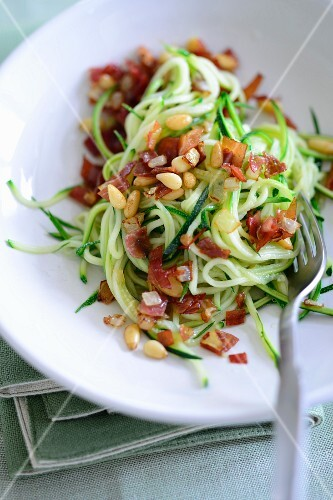 Courgette spaghetti with bacon and pine nuts