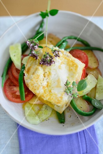 Baked feta cheese in rice paper on a vegetable salad
