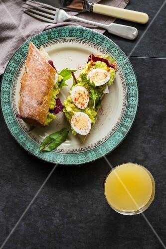 A quail egg and avocado sandwich