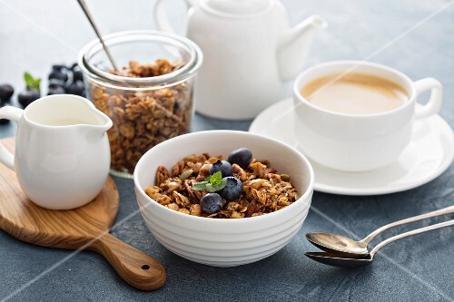 Homemade muesli with milk for breakfast served with coffee