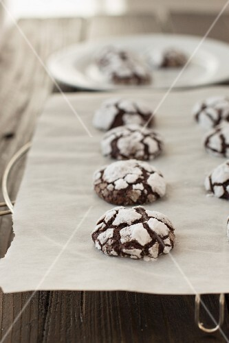 Chocolate crinkle cookies on a piece of baking paper