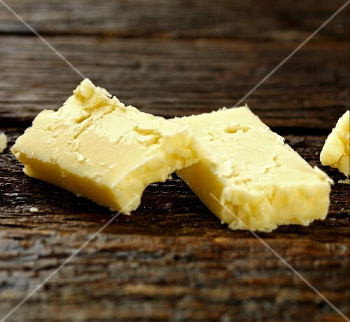 Cheddar cheese on a wooden surface